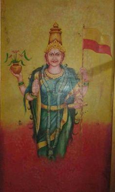 Shree Kannadambe Bhuvaneshwari Devi holding Kannada Flag