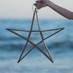 Portavela estrella en oro viejo.