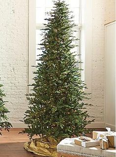 Enjoy the beauty of a full Christmas tree every year with the Mountain Pine Pencil Christmas Tree that's perfect for limited spaces and is pre-lit for convenience.