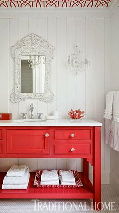 vanity painted red, ceiling wallpapered towels ruffled - love this bathroom