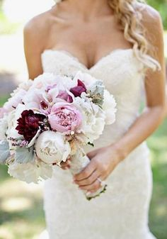 White and pink peonies in a ribbon-wrapped bouquet with accent marsala, burgundy, rich red blooms makes for an utterly ROMANTIC bridal style! Fall in LOVE with these 15 Of The Prettiest Pink Peonies For Your Wedding • Wedding Ideas magazine