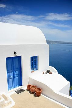 This is Santorini. And this is the door I want to walk through. LOVE all the blue doors there!
