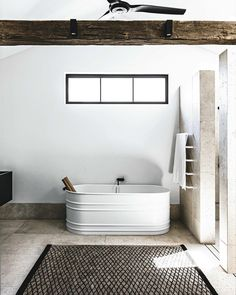 INTERIORS: From our Kitchen and Bathroom Hot 100 list in the current issue - Sydney bathroom by @handelsmannkhaw. In the main bedroom, @agapecasa Vieques steel bathroom from @artedomus, rug from @robyncosgroverugs. Produced by @anna_delprat photographed by @felix_forest #loveVL #VogueLiving #bathroom #artedomus #agape #interior #interiordesign