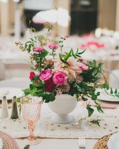 Click to find out what blooms were used in these classic wedding #centerpieces | marthastewartweddings.com