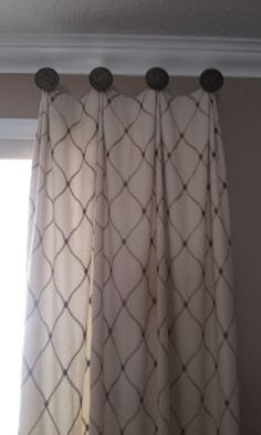 Custom side panels - hand pleated and hung from 4 posts with medallions - Catherine Pulcine Decorating Den Stittsville designer