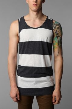 simple stripe  tank top and vibrant tattoo