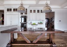 Kitchen Island and table. Kitchen with table connected to kitchen island. Pendant Lighting are by Visual Lighting #KitchenIsland #KitchenIslandTable #KitchenDesignIdeas #Kitchen Veranda Estate Homes & Interiors