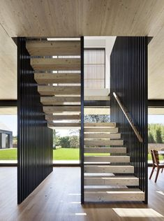 Modern Stairs // wood and steel stairs at Piersons Way designed by bates   mass architects Stairways, ideas, stair, home, house, decoration, decor, indoor, outdoor, staircase, stears, staiwell, railing, floors, apartment, loft, studio, interior, entryway, entry.