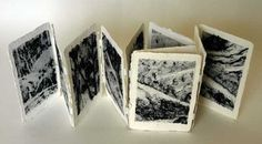High Country by Katherine Nix. 15 x 11 x 2 cm. Dyed kenaf paper, rag paper and gesso. In the March after the bushfires of January 2003 I drove through Kosciuszko National Park. There was a stark beauty to the fire-ravaged landscape & already signs of green rebirth. This little book grew out of drawings I made on that trip