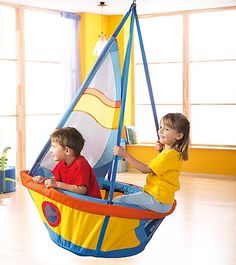 "Ship's Seesaw Swing. Hang in a playroom or bedroom for smooth sailing good times for little landlubbers. Kids set sail on imaginary sea adventures then drop anchor when it's dinnertime. Includes adjustable hanging hardware. Made of soft upholstered fabric over a sturdy aluminum frame, with mesh portholes to peek out, nylon sail and weighted anchor for hours of pretend play. Imported. For ages 3 and up. Size 39-1/2""L x 27""W x 60""H Holds up to 176 pounds total weight."