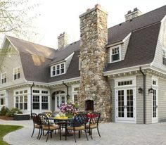 gorgeous house. love the idea of the fireplace up against the house.  it flows well.