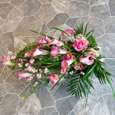 Hand tied funeral spray with callas and roses