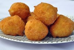 (mexican style donut holes!!) These tasty fried sweet dough balls sprinkled with cinnamon sugar are a popular treat in Mexico and Latin America. The recipe originates from Spain and is perfect served with hot chocolate or coffee. Can be sprinkled with cinnamon sugar or powdered sugar.