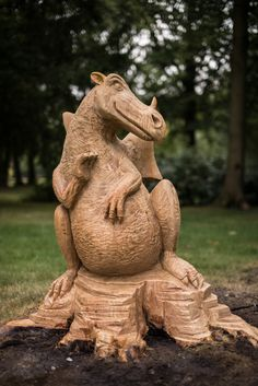 cute little dragon carved from a Sweet Chestnut stump for a private customer's garden in Hertfordshire.
