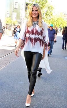 Heidi Klum balances her form-fitting leather leggings with a loose-fitting printed top.