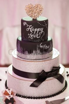 Decorated chocolate wedding cake with brown ribbon on table #wedding