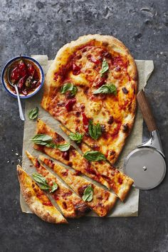 To give the classic Margherita pizza a spicy kick, we season the tomato sauce with red pepper flakes and a touch of cayenne. You'll have some sauce left over; store in the refrigerator and make this spicy pizza margherita pizza again later in the week. Vegetarian Recipes, Cooking Recipes, Healthy Recipes, Vegetarian Pizza, Skillet Recipes, Cooking Tools, Rustic Pizza, Mushroom Pizza Recipes, Spicy Pizza