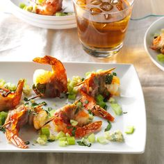 Bacon-Wrapped Blue Cheese Shrimp Recipe -Blue cheese, bacon and basil pack big flavor into a couple of bites. To save time, you can assemble the skewers the night before and then serve them hot from the broiler on the day. —Vivi Taylor, Middleburg, Florida