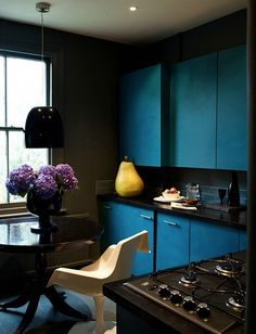 Abigail Ahern designed kitchen. Great dark colors.
