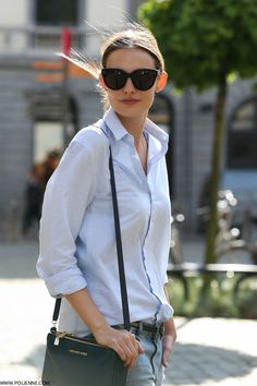Paulien Is Wearing A Light Blue Shirt From Good Genes, Belt From IKKS, Distressed Denim Jeans And Bag From Michael Kors And Sunglasses From...