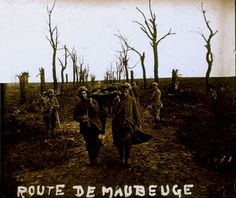 Evacuating a wounded on the remains of the Maubeuge road. The perspective and composition of this picture is utterly amazing.