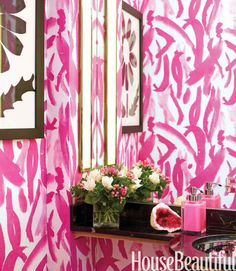 """Designer Amanda Nisbet upholstered the powder room walls in one of her own fabrics, custom-colored in """"hot, hot, hot pink."""""""