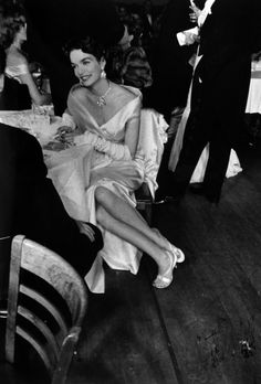 Robert Frank - Gloria Case in Opera Club during intermission on opening night of season at the Met Opera House, NYC, 1954