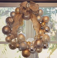 Got more ornaments than will fit on your tree? Believe it or not, all you need to create this gorgeous ornament wreath is a wire hanger, a pair of pliers, a pretty ribbon and about 70 spare ornaments.