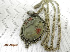 An  Altered  Lady Cameo Necklace by TreasuresofJewels on Etsy, $20.00