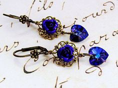 """$27 Gorgeous romantic Swarovski crystal heart earrings. Heliotrope crystals are magnificently vibrant and sparkling! About 2"""" long."""