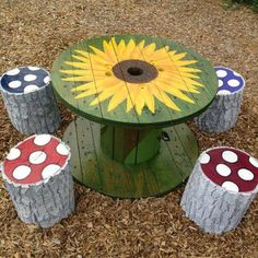Wooden cable reel table and tree stump chairs
