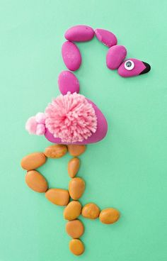 DIY Flamingo Rock Puzzle. Turn painted rocks into this fun animal flamingo rock puzzle for kids.