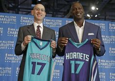 NBA commissioner Adam Silver, left, and Charlotte Hornets owner Michael Jordan, right, pose for a photo during a news conference to announce Charlotte, N.C., as the site of the 2017 NBA All-Star basketball game June 23, 2015.