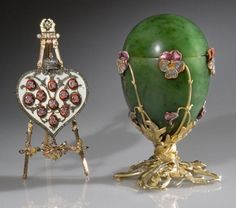 """The """"Pansy"""" Fabergé Egg: Presented by Nicholas to his mother Marie.  The surprise is a gold easel with a white enameled, diamond-studded heart.  There are 11 miniature strawberry colored lockets, which open to reveal miniature portraits of each of the members of the Czar's royal family"""