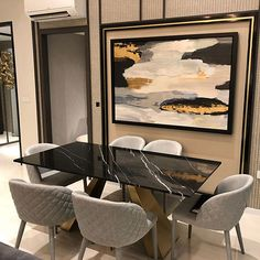 Elegant and versatile dining table with natural marble tabletop and stainless steel legs, which are available in gold, rose gold or black coating.