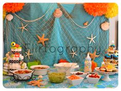 Baby Shower: Baby Boy - Ahoy, It's A Boy! - Tropical - Summer Colors.    A creative creation that I worked on with my Mother-in-Law. It was really fun to dream up the concept for my Sister-in-Law's Baby Shower. It was a hit. Loved the colors and how creative we could get with this color scheme.     Photo by: Flirtography  www.facebook.com/flirtography