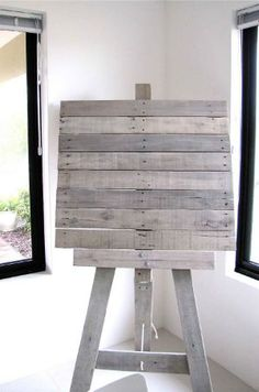 Pallet turned art easel.  Paint with chalkboard paint and put it outdoors by the kids park!