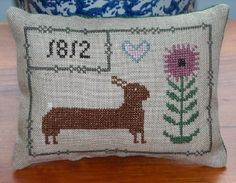 Cross stitch Easter pin keep or small pillow done on linen.  Design by HomeSpunPrims by Lori Rippey.