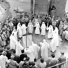 A Druidical ceremony probably on Summer Solstice whithin the stones attended by male and female Druids and watched by members of the public.  Photographer: R J C Atkinson  Date Taken: June 1958  © English Heritage.NMR  Reference Number: P50246