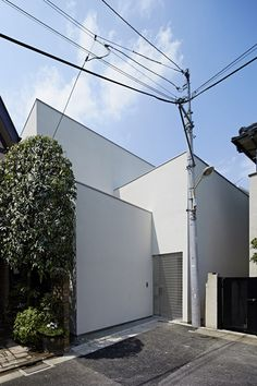 House in Jingumae by PANDA has slotted a boxy family house onto a plot hemmed in by other residences on all four sides. The property is only revealed to the street at one corner. Once you enter the property, the sight of neighboring houses vanishes instantly. room area and the dining room area. http://www.dezeen.com/2014/06/30/house-in-jingumae-by-panda/