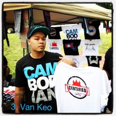 "While a slew of urban clothiers have arisen in the past few years, no one has seen as much growth and popularity as Jacksonville's #Van #Keo. The 24-year-old Keo is the founder and CEO of CamboFresh Clothing. Their signature ""CAM BOD IAN"" tees have gone viral with Khmer American youth and hip hop artists, notably JL Jupiter (R, in photo), Vandaliss and Golden Chyld. A nascent media partnership with the Khmerican along with consistent new designs will keep Keo's clothin..."