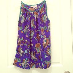 Ann Taylor Loft Sleeveless Top Very cool Ann Taylor Loft Sleeveless top. The size is a medium petite. It has a royal blue background with mint, tan and cream paisley print.  The material is 100% polyester and is machine washable. Perfect boho look. Ann Taylor Tops Tank Tops