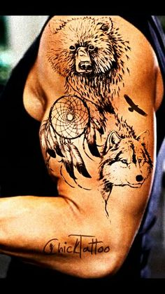 A grizzly, wolf, and dream catcher tattoo. How cool!