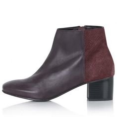 <p>€ 60 - <a href='http://eu.topshop.com/en/tseu/product/new-in-this-week-2169943/new-in-this-week-485158/bennet-suede-mix-ankle-boots-4766551?bi=1&ps=200' target='_blank'>Topshop</a></p>