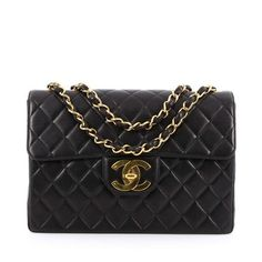 This authentic Chanel Vintage Classic Single Flap Bag Quilted Lambskin Jumbo is a timeless essential for any modern woman. Crafted from beautiful black lambskin leather, this coveted classic flap features Chanel's signature diamond quilting design, exterior back pocket, woven-in leather chain strap, and gold-tone hardware accents. Its CC signature turn-lock closure opens to a burgundy leather-lined interior with zip and slip pockets storing all daily essentials. A classic, stand-out piece...