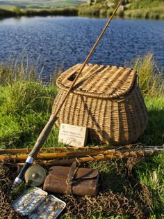 A Split-Cane Fly Rod and Traditional Fly-Fishing Equipment Beside a Trout Lake in North Wales, UK by John Warburton-lee.  #fishing #trout