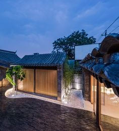 archstudio twisting courtyard in beijing is the renovation of a siheyuan turning it into a lively public space within the inner city. Japanese Architecture, Space Architecture, Chinese Courtyard, Zen House, Brick Paving, Casa Patio, Studios Architecture, Courtyard House, Traditional House