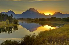 Sunset with Reflection from Oxbow Bend with Jackson Lake. Moran, Wyoming, United States.