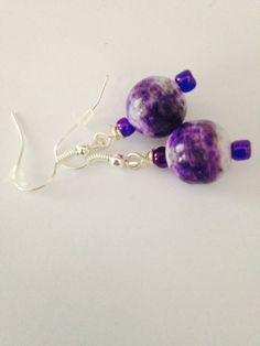 A personal favorite from my Etsy shop https://www.etsy.com/listing/243844367/purple-earrings-round-earrings-dangly