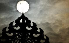 Planet Venus, pictured as a black dot, is seen in transit across the Sun in New Delhi, India on June 6. Sky-gazers around the world held up their telescopes and viewing glasses to watch a once-in-a-lifetime event as Venus slid across the sun. (Manan Vatsyayana/AFP/Getty Images) #